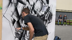 Graffiti artist working in the street Stock Footage