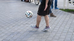 Man doing tricks with football in the street - stock footage