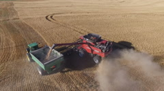 Aerial of Combine Harvester Unloading into Grain Cart (Kansas USA) Stock Footage