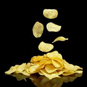 Many potato chips with falling chips Stock Photos