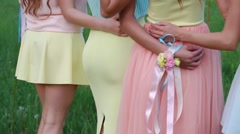 Four girls embracing. Beautiful dresses and skirts.Nature and fresh air. Stock Footage