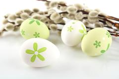 Color easter eggs with catkins on table Stock Photos