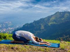 Sporty fit woman practices yoga asana Balasana - stock photo