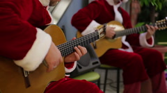 Guitar players performing merry songs for festive mood of shopping mall visitors Stock Footage