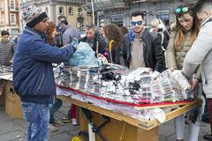Naples, Italy - March 28, 2016: Vendor, immigrant, and his stall Stock Photos
