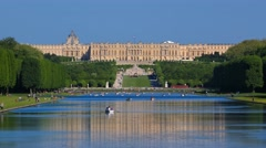 People enjoying rowing boats in a pond at Versailles Stock Footage