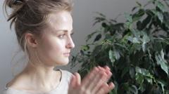 Woman rubs her eyes Stock Footage