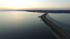 4K. Flight over road in the water in early spring on sunset, aerial view. Stock Footage