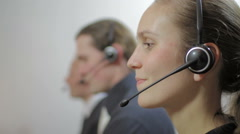Woman working at customer service call center Stock Footage