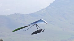Glider taking off the mountain, tracking shot Stock Footage