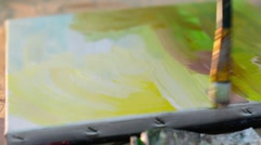 Young Artist Painting a Picture with Oil Paints on the  Natural Canvas Stock Footage