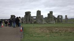 Tourist crowd Prehistoric Stonehenge monument Amesbury England 4K Stock Footage