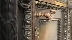 Solid ancient a bronze door closes Stock Footage