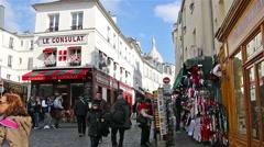 PARIS, FRANCE: People walking on streets of Montmartre Stock Footage