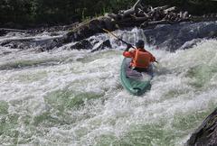 Kayaker in whitewater - stock photo