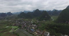 AERIAL DOLLY SHOT OF CHINESE COUNTRYSIDE - RIVER - AND MOUNTAINS Stock Footage