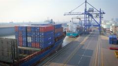 Aerial view of shipping containers unloading at UK port Stock Footage