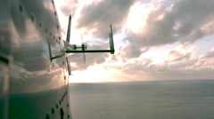 Slow motion of side of helicopter over water Stock Footage