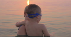 Mother and Son Swimming in the Sea Together Stock Footage
