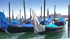 View to gondolas and San Giorgio Maggiore venice, Italy, panning shot Stock Footage