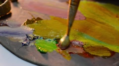 Young Painter Mixed Colors in Palette. Art Background Stock Footage