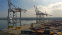 Rising shot ABP cranes and containers at Southampton Port UK, filmed by drone Stock Footage
