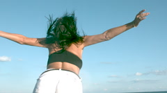 Slow motion woman with open arms in wind Stock Footage