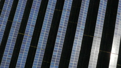 Aerial drone footage of UK solar panel farm with sun - stock footage