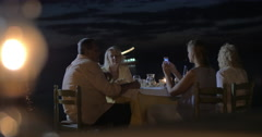 Taking photos during family dinner on the beach Stock Footage
