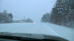 Driving Down Snow Covered Road - stock footage