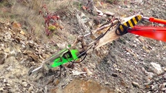 Excavator with demolition hammer in a construction site Stock Footage