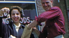 1961: Lush adults buy mini booze alcohol bottles happy times ahead. Stock Footage