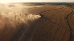 Dusty Sunset Aerial as Combines Harvest Wheat (Kansas USA) - stock footage