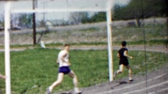 1958: Long distance high school track foot race rounding corner. Stock Footage