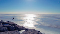 People Going Ice Fishing On Frozen Lake Erie - stock footage