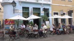 Tourists sit at cafe in Salvador historic center, Brazil Stock Footage