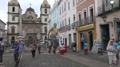 Tourists and local people in street of Salvador, Brazil Stock Footage