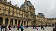 PARIS, FRANCE: tourists walking near Louvre in Paris, France Stock Footage