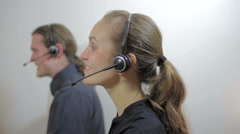 Smiling woman working at customer service call center - stock footage