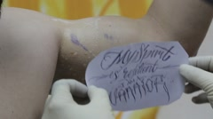 Placing Tattoo Stencil Transfer Stock Footage