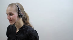 Woman at support call center talking on the phone Stock Footage