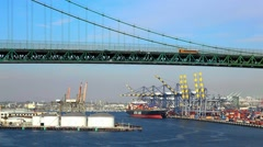 Cargo Container Ship terminal and Vincent Thomas Bridge in San Pedro Stock Footage