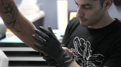 Attaching ink stencil for tattoo - stock footage