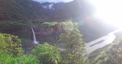 Bright Sun between the Mountains and a Waterfall Stock Footage