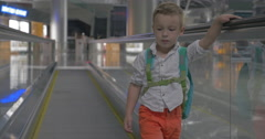 Cute little boy on travelator in airport Stock Footage