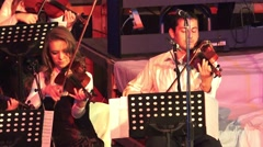 Violin orchestra players at New Year Performance - stock footage