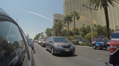 Cars vehicles waiting in traffic on Las Vegas Boulevard with Mandalay Bay casino - stock footage