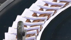 Newspaper conveyer belt transportation line Stock Footage