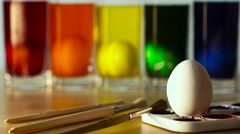 Five Easter Eggs in Color Thick Glass Tumblers Stock Footage