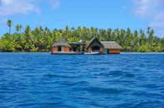 Exotic home over water Huahine French Polynesia - stock photo